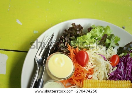 Steaks, french fries with vegetables salad on a plate
