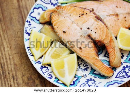 Steaks roast red fish with lemon and spices - stock photo