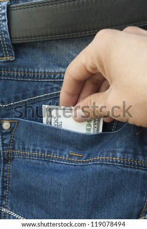 Stealing money from the pocket of his jeans