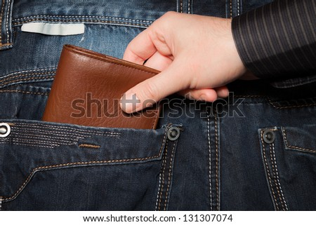 Stealing wallet from back pocket - stock photo