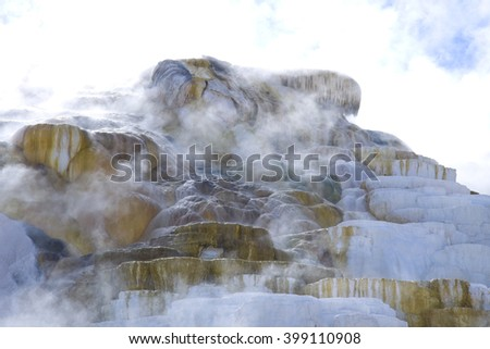 Steam and Ripple patterns at mammoth hot springs in Yellowstone national park - stock photo
