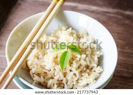 steam brown rice in china cup