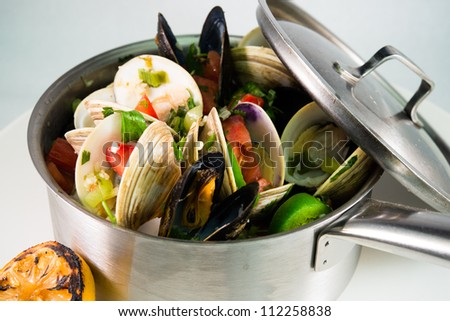 Steam Clams and Muscles: A  beautiful pot full of steamed clams and muscle shellfish seafood - stock photo
