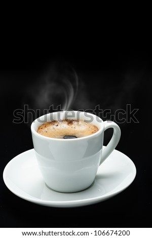 Steam coming out of coffee cup, on a dark background - stock photo