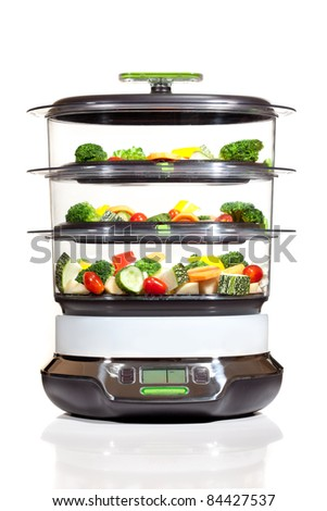 steam cooker with vegetables on a white background - stock photo