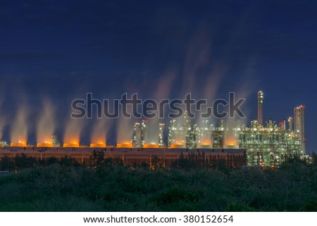 Steam cooling tower and process building of oil refinery plant. - stock photo