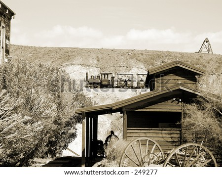 Steam engine powered narrow gauge rail car chugs through the hills of the desert mining town of Calico - stock photo