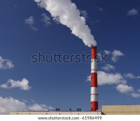 Steam from a pipe against the dark blue sky