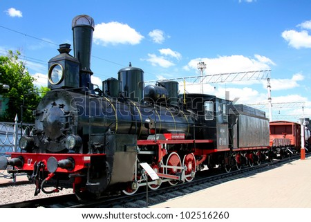steam locomotive on a background of blue sky - stock photo