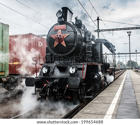 steam locomotive on the tracks (made in the Czech Republic 1948 - Matej, number 433002) - stock photo