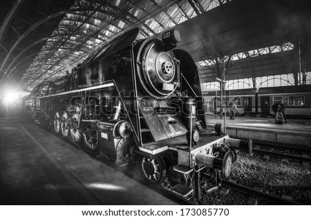 steam locomotive stands on the platform of the station. - stock photo