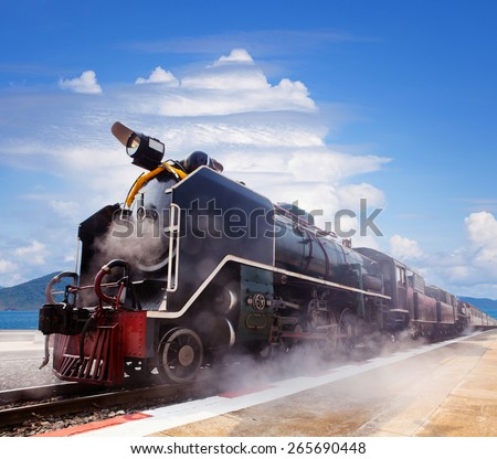 steam locomotive trains in railways station platform preparing to moving to traveling against beautiful blue and cloudy sky - stock photo