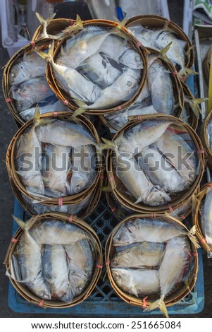 Steam mackerel in bamboo basket - stock photo