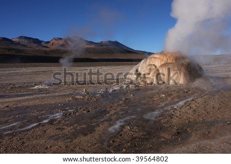 Steam of geysers in the morning light of Altiplano