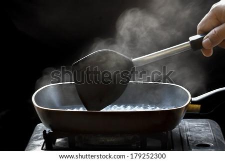 steam on pan in kitchen - stock photo