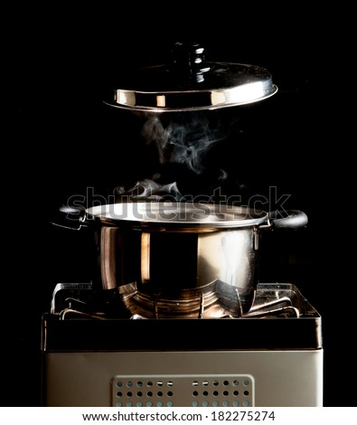 steam over cooking pot - stock photo