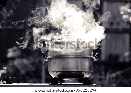 steam over cooking pot in kitchen