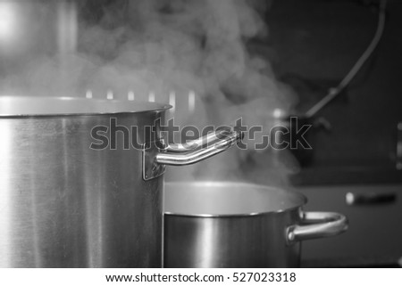 steam over cooking pots