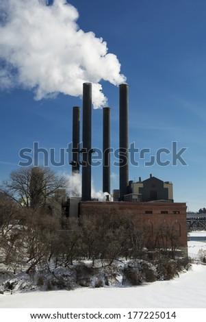 Steam power plant on the Mississippi river, Minneapolis, Minnesota, USA - stock photo