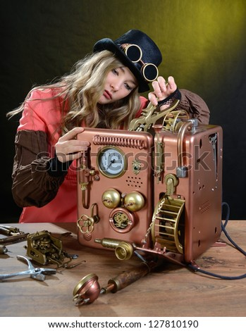 Steam punk girl repairing Phone. Telephone - Hand/home made model. - stock photo