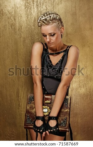 Steam punk girl with a book - stock photo