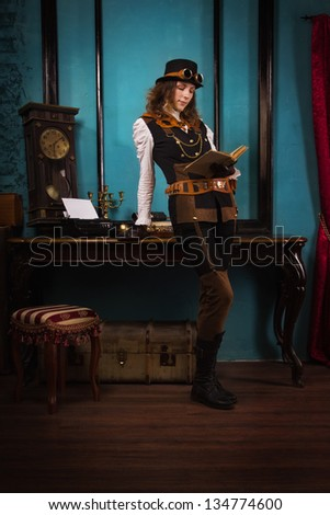 Steam punk girl with old book in the hands