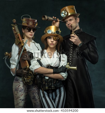 Steam punk style. The people of the Victorian era in an alternate history. Steampunk two women and a man. - stock photo