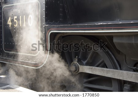 Steam rising from a steam engine.