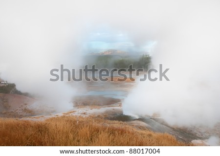 Steam rising from Porcelain Basin framing the distant mountains in Yellowstone National Park.
