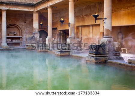 Steam rising off the hot  mineral water in the Great Bath, part of the Roman Baths in Bath, UK - stock photo
