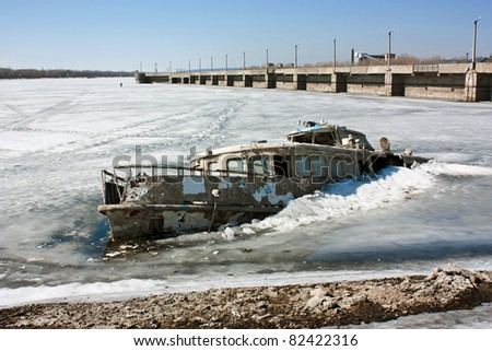 Steam-ship sunk in the ice of the Gulf River - stock photo