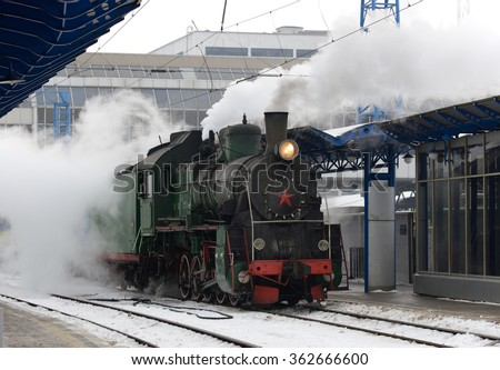Steam train arrives at the station - stock photo