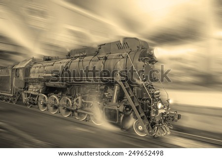 Steam train goes fast on the night station background. Vintage style image. - stock photo