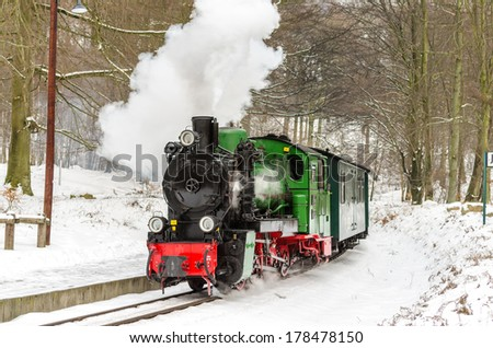 steam train in winter - stock photo
