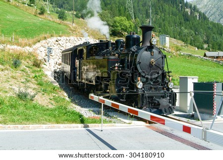 Steam train on the Swiss alps - stock photo