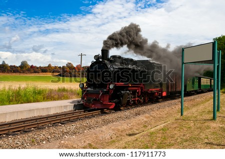 Steam train with black smoke; island Rugen, Northern Germany