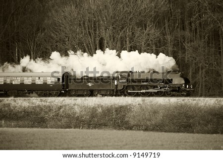 steam trains in black and white with sepia tint - stock photo