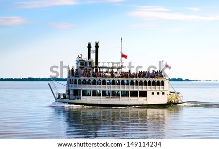 Steamboat on Lake Ontario near Toronto for a summer cruise and celebration on a sunny day - stock photo