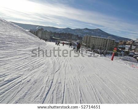 STEAMBOAT SPRINGS, COLORADO - JAN 30 - Skiers slide into the base area on Jan 30, 2010, in Steamboat Springs, Colorado - stock photo
