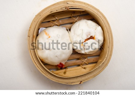 steamed Chinese bun in bamboo basket isolated on white background,yumcha, dim sum in bamboo steamer, chinese cuisine - stock photo