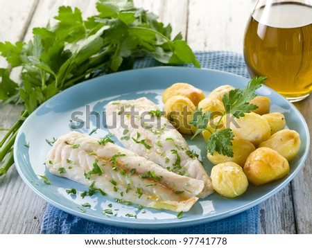 steamed cod with parsley and potatoes - stock photo