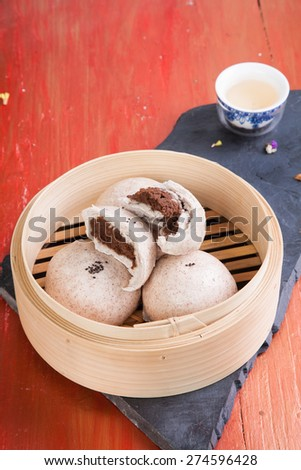steamed dumpling  in  red  background / Vegetarian chinese bun . - stock photo