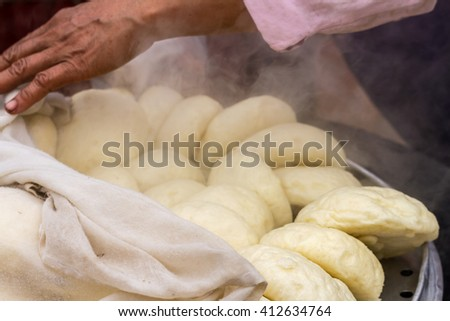 Steamed dumpling(salapao) hot from the oven in the morning at market - stock photo