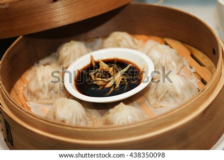 Steamed dumplings or dim sum with sauce in bamboo stew - stock photo