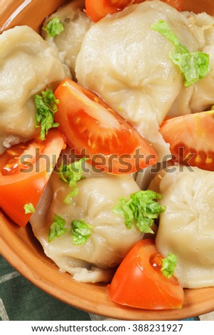 Steamed dumplings with tomato above view closeup
