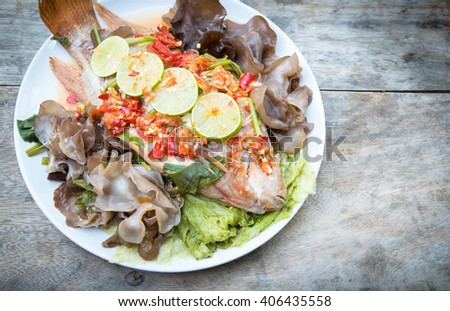 steamed fish in spicy sauce, Thai style food - stock photo