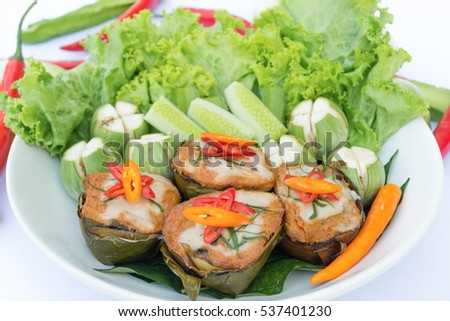 Steamed fish with curry paste Thai food in white plate on white background.