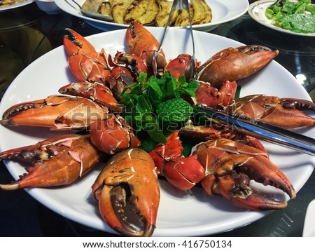 Steamed Giant crab claws-seafood plates, served with spicy sauce, Bangkok, Thailand