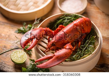 Steamed lobster in bamboo steamer - stock photo
