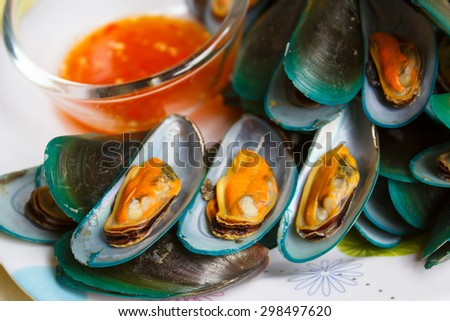 Steamed mussels and spicy sauce, Thai food. - stock photo